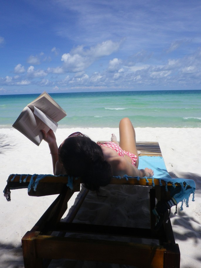 Reading on the beach in Vietnam