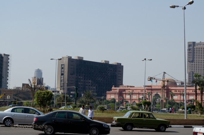 Tahrir Square and burned out buildings