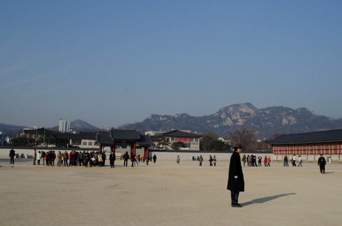 A security guard keeps the tourists in check at Gyeongbokgung Palace