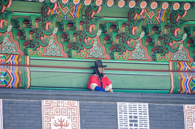 A guard presides over the ceremony at Gyeongbokgung Palace