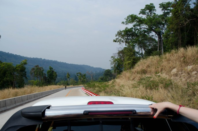 Riding in the back of a pick-up truck to reach Preah Vihear Temple