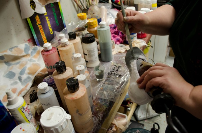 Painting ballet shoes to match the dancer's tights