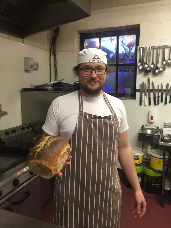 Baker Zac with one of the mill's wholemeal loaves