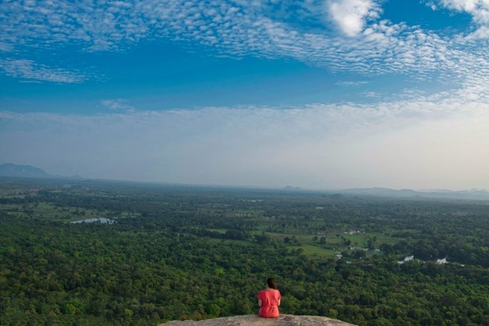 Girl looking at the view from Pidurangala Rock