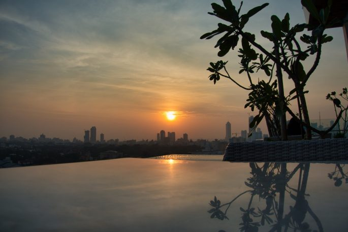 Sunset over the infinity pool at Jetwing Colombo Seven's rooftop pool