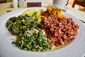 Plate of red rice and healthy ayurvedic salads at Barberyn Sands Resort, Sri Lanka