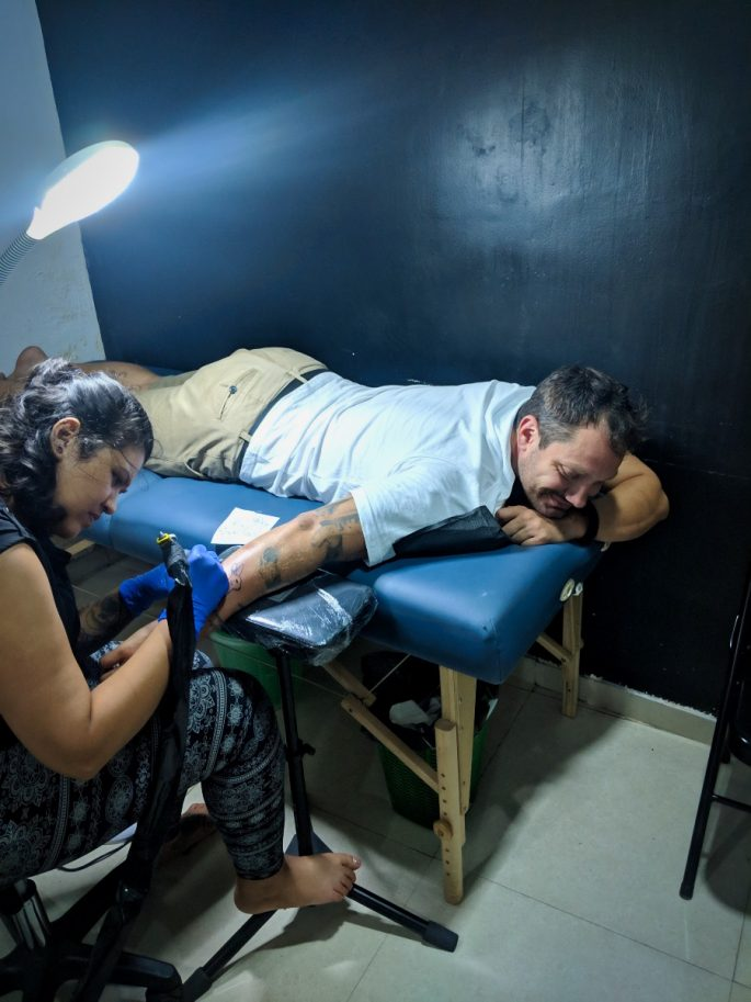 Sitting in the tattoo parlour in Colombo