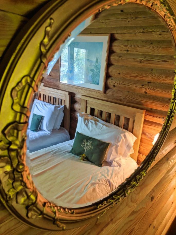 Mirror in log cabin