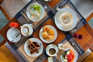 Breakfast table with various Sri Lankan food at Anantara
