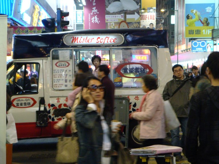 Ice cream seller in the middle of the neon madness
