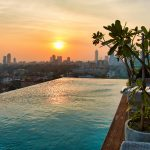 sunset seen from outdoor rooftop pool over Colombo